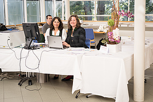 Manuela and Bettina at the registration desk