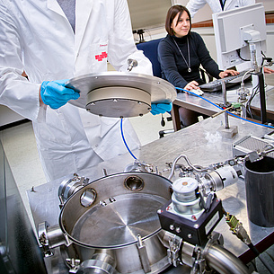 Three scientists at research in a lab. Photo source: Lunghammer - NAWI Graz
