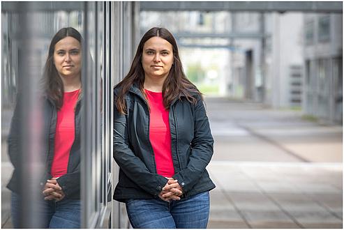 TU Graz researcher in front of an institute building