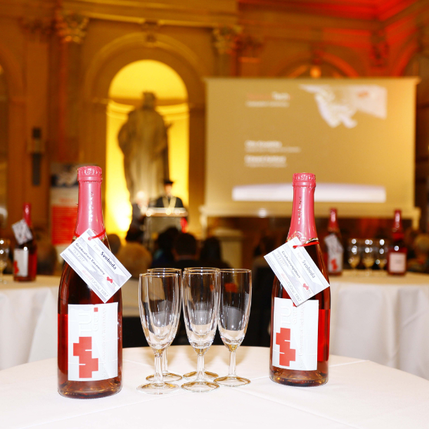 Sparkling wine bottles on a table at an event