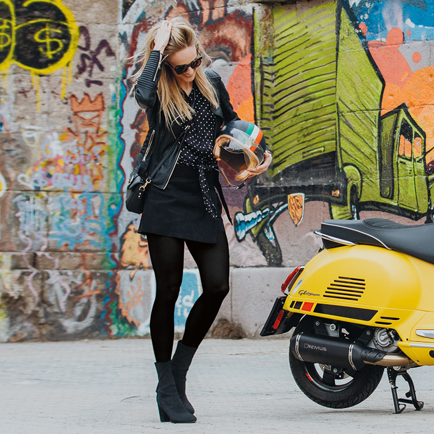 Young woman and motorbike