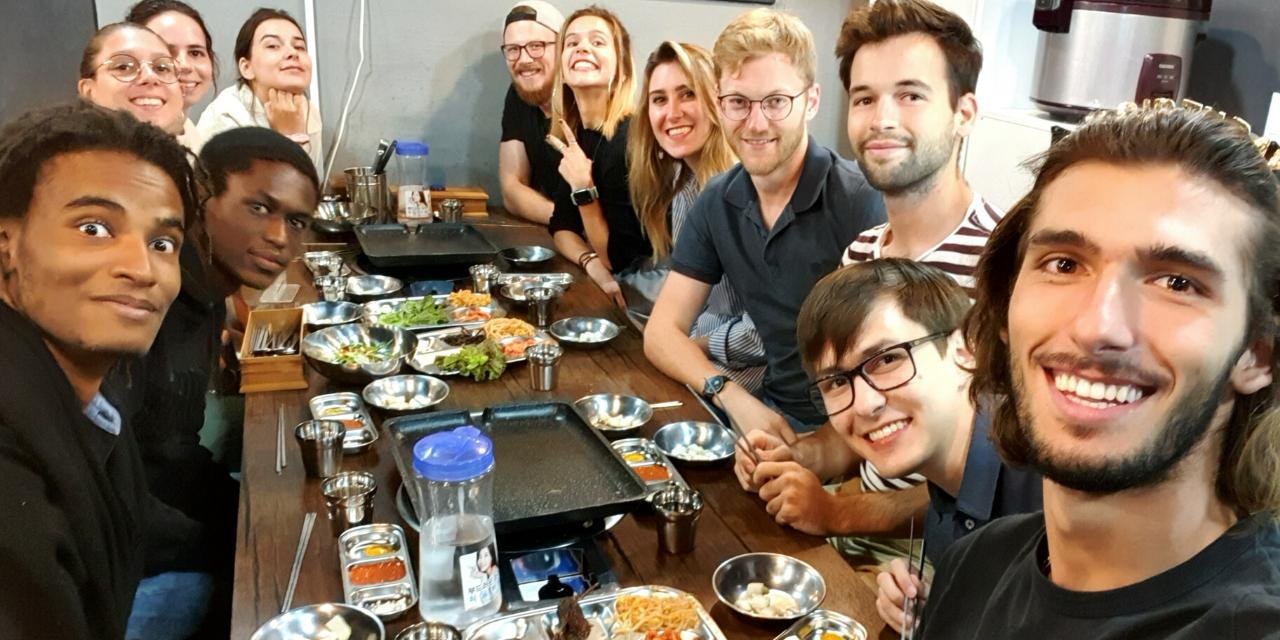 people sitting together having dinner